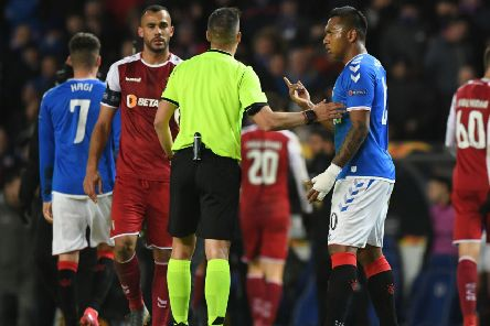 Rangers' Colombian striker Alfredo Morelos exchanges words with referee Xavier Estrada. Picture: Craig Foy/SNS