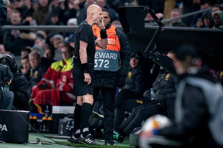 Referee Sergei Karasev checks the VAR monitor during Celtic's match against FC Copenhagen. Photograph: Liselotte Sabroe/AFP/Getty