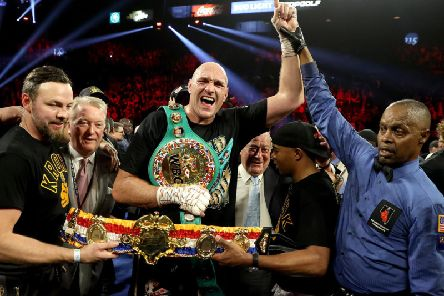 The celebrations begin for Tyson Fury after his seven-round victory over Deontay Wilder. Picture: Getty Images
