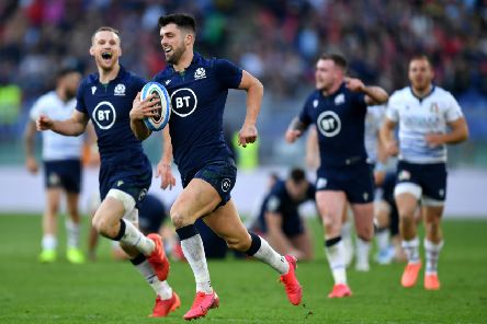 Adam Hastings runs in Scotland's third try in Rome. Now Gregor Townsend's side must take the momentum into the France and Wales game. Picture: Dan Mullan/Getty Images