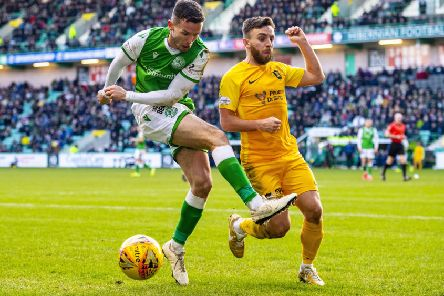 Hibs' Stephen McGinn and Livingston's Steven Lawless. Picture: SNS