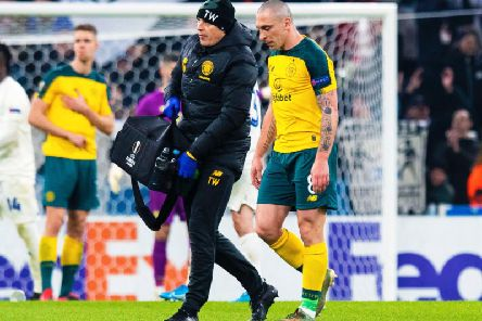 Scott Brown leaves the field with an injury during the first leg of Celtic's clash with Copenhagen