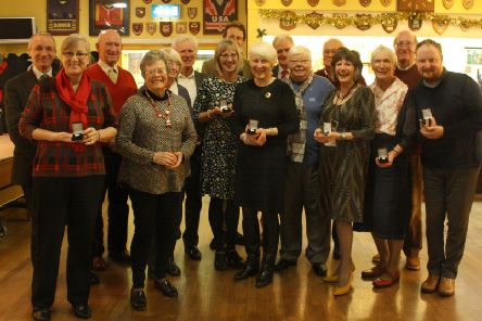 Abbotsford Trust chairman James Holloway and chief executive Giles Ingram giving  five-year service awards to volunteers Hamish Reid, Sandra Davies, Keith Crosier, Malcolm Morrison, Jack Scott, Ian Skinner, Maggie Allan, Gill Howes, Margaret Cassidy, Carole Evans, Marian Keith, Nancy Marshall, Joyce Cook and Frankie McBrier. Not pictured but also given awards were John and Margaret Collin, Simon Hemsley, Allan Herd, Derek Martin, Dawn McKenna, Mary Robertson and Linda Murray.