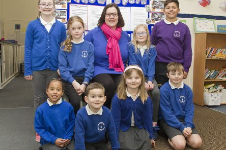 Celebrating Knowepark Primary School's success are, back from left, Elsa Ferguson, Casey Pemberton, headteacher Lynn Hodgins, Paige Domin and Ryan Singh-Joor, with, front, Bronny Bowers, Hayden McAllister, Ava Lawne and Rory Tomlinson.
