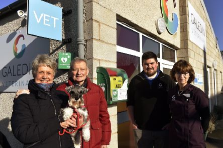 Jacky and Hamish Ritchie, with their dog Penny, vet Robbie Norquary and receptionist Sheila Fleming.