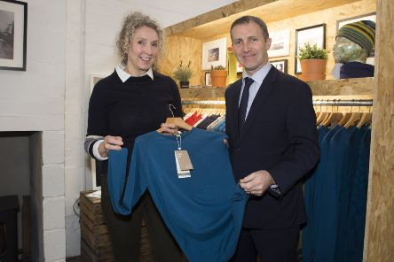Findra clothing founder Alex Feechan shows Infrastructure Secretary Michael Matheson round the Findra clothing design hub in Innerleithen.