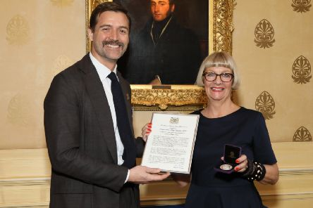 Telly design judge Dr Patrick Grant awards Professor Sheila-Mary Carruthers her silver medal.