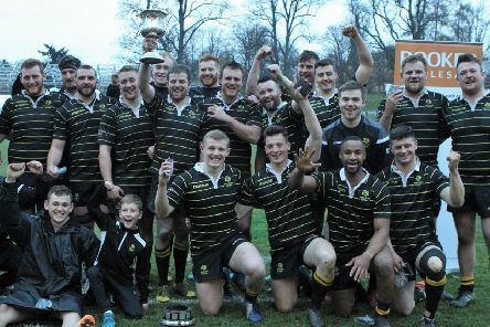 Members of the Melrose squad celebrate (picture by Douglas Hardie).