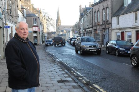 Selkirkshire councillor Gordon Edgar in Selkirk High Street. (NB taken on  a Sunday to no illegal parking going on!)