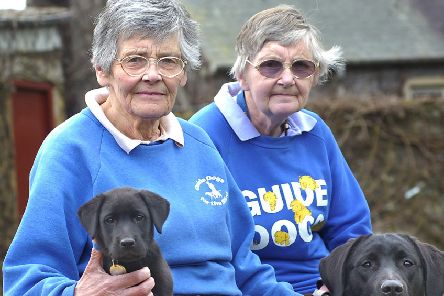Betty, left, and Alison pictured with their training dogs in 2008.