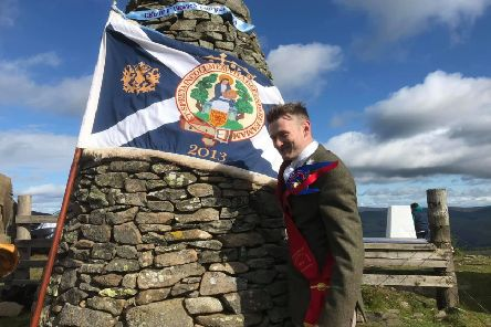 Royal Burgh Standard Bearer Craig Monks at the Three Brethren this morning. Photograph: Grant Kinghorn.