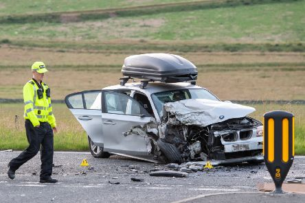 The silver BMW 1 Series car after Saturday night's crash at Cardrona. Photo: Ian Georgeson