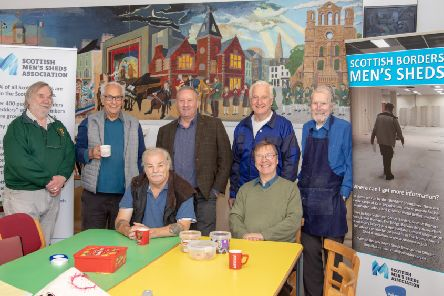 Borders Men's Shed Development Officer Ross Hall (back row, centre) with members of Kelso Men's Shed.