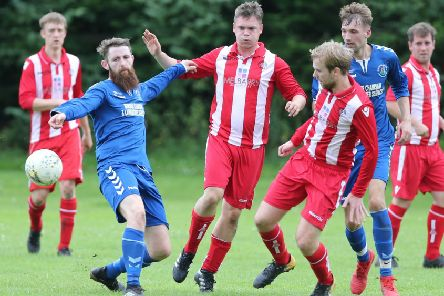 Tweedmouth Rangers (in stripes) in action against Earlston Rhymers (picture by Brian Sutherland).