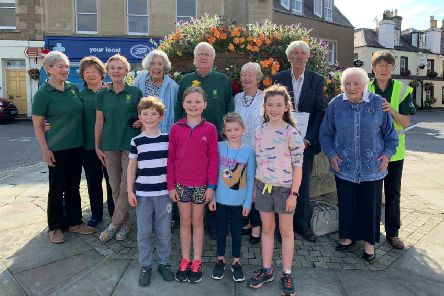 Melrose was looking its blooming best last Thursday when two Keep Scotland Beautiful judges cast their eyes over the latest horticultural efforts of a band of dedicated volunteers.'Terry Stott and Sandra MacLennan were met by two of the oldest and several of the youngest Melrose In Bloom members at the beginning of their judging visit at the Market Cross.