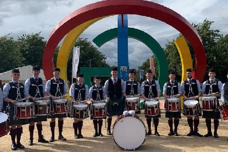 Hawick's Ross Elliot,  Sarah Rowley from Galashiels and Jedburgh's Kathryn Wylie win the Grade 3A World Pipe Band Championships as members of Edinburgh-based Stockbridge Pipe Band.