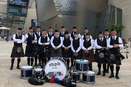 Scottish Borders Pipe Band performs at the Guggenheim museum in Bilbao as part of the Getxo International Folk Festival.