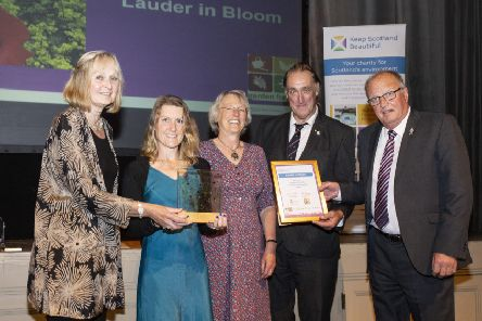 Melrose in Bloom volunteers Gill and Ross Findlay, Val and John Miller and Owen and Pam Edwards with Lindsay Montgomery.