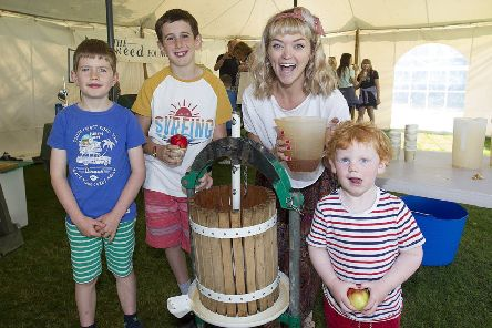 Fergus Rawson, Isaac Stuart and Hamish McLeman press apples with Charlotte Watson from Greener Melrose.