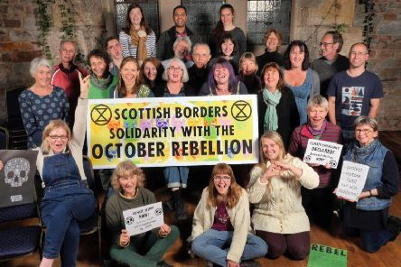 Members of Extinction Rebellion Scottish Borders last week gathered in Galashiels, pictured, to show solidarity with hundreds of thousands of other campaigners in more than 60 cities around the world