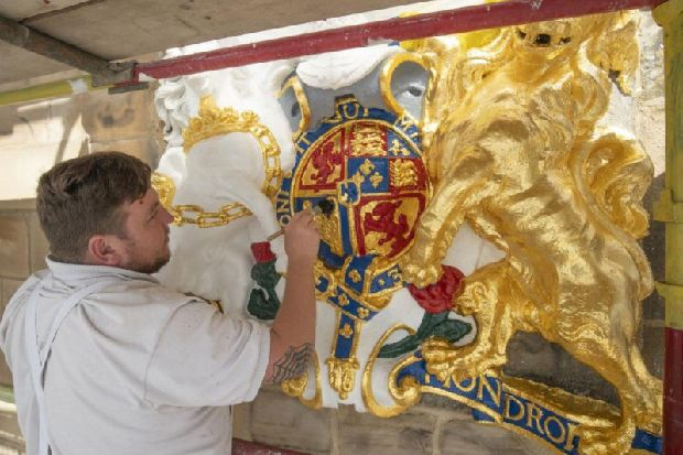 Queen's local kirk in Edinburgh back to its best as coat of arms restored
