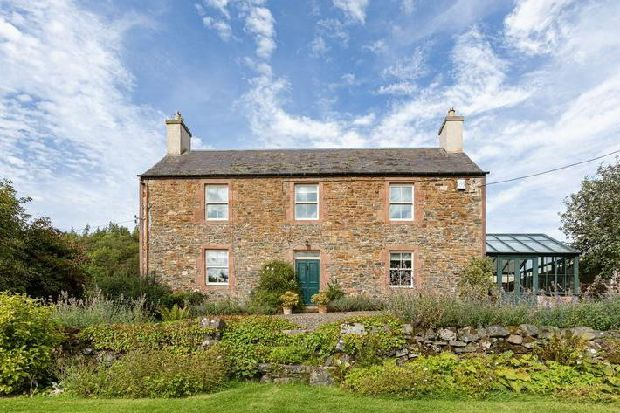 Take a look inside this Scottish farmhouse with period features and over three acres of land
