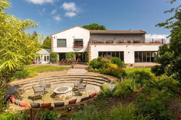 Take a look inside this 1.45m Edinburgh home with roof terrace, gardens and wonderful views