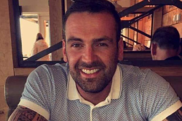 Third man arrested over death of father Gary More, gunned down outside his home