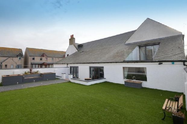 Take a look inside this former Scottish nightclub that's now a six-bedroom home with swimming pool
