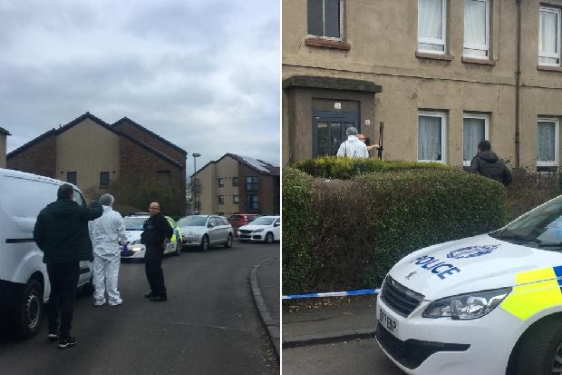 Police tape off property in Edinburgh after death of 79-year-old woman