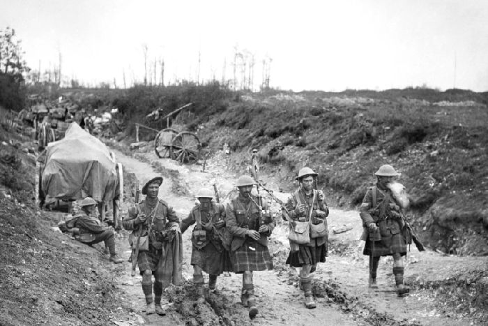 A piper of the 7th Seaforth Highlanders leads four men of the 26th Brigade after the attack on Longueval in 1916. Photograph: Lt. J W Brooke/ IWM via Getty Images