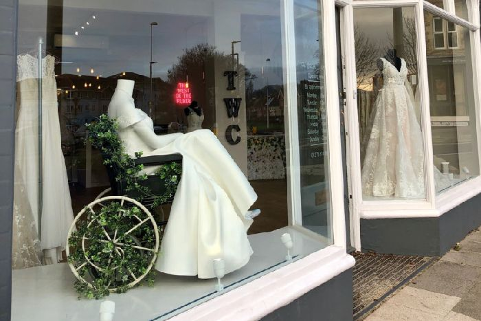 900206d88b6bd The White Collection bridal shop window with a mannequin in a wheelchair.  Picture  Beth