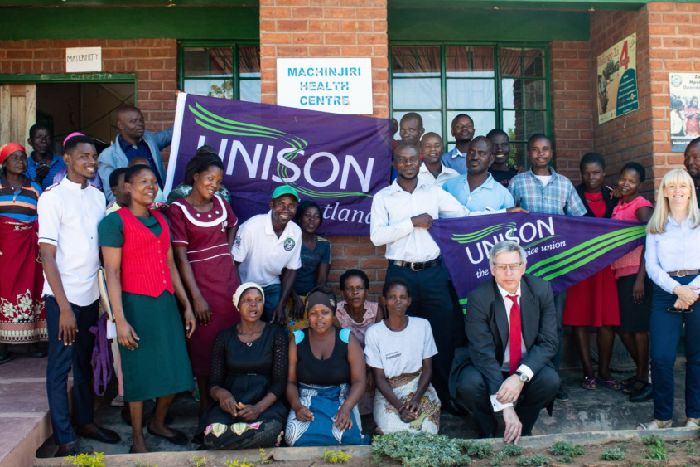 Unison's Gordon MacKay, with red tie, and Wilma Brown, far right, with staff and patients  at the maternity clinic in Machinjiri (Picture: Danny Phillips/Unison Scotland)