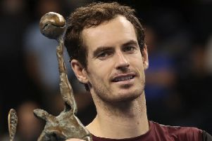 Andy Murray of Britain poses with the trophy after winning the European Open final in Antwerp (Picture: Francisco Seco/AP)