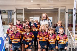 Scotland international Mairi Forsyth with the Deeside RFC Minis, P4 champions at Deeside Minis/Micros Festival