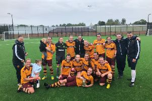 Motherwell Ladies players and management celebrate winning league (Pic by Andy Ross)