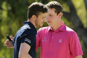 Connor Syme embraces fellow Scot Bob MacIntyre after knocking him out of the World Super 6. Pic by Getty.