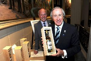 Sir Jackie Stewart and RAC chairman Tom Purves with the new single malt.