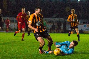 O'Kane is taken down by the Albion Rovers goalkeeper during the 2-0 victory over the Lanarkshire side