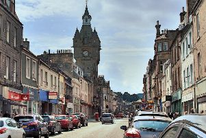 Santander's branch, on the left, in Hawick High Street.