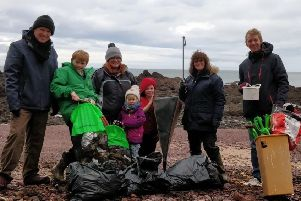 The Haddow family help pick up litter of the beach at Killiesdraught.