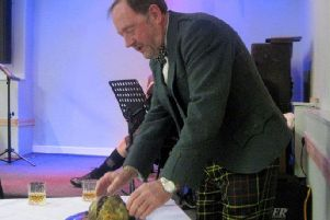 Rob Bell addresses the haggis at the Coldstream Burns Club's ladies night..
