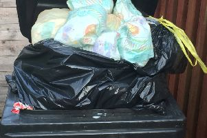 The council has refused to rule out three-weekly bin collections.