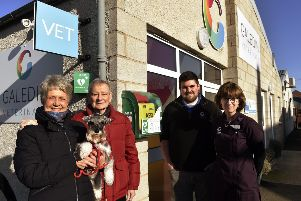 Jacky and Hamish Ritchie, with their dog Penny, and Galedin Vets vet Robbie Norquary and receptionist Sheila Fleming.