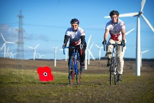 Fran Tierney  and Fred Olsens UK operations manager, Stuart Naylor cycling at Crystal Rig wind farm.