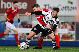 Jamie Gallagher and Mark McConnoll tussle during Shire's defeat. Picture: Michael Gillen.
