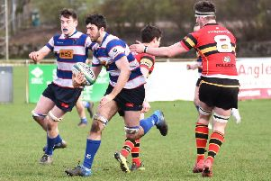 Jamie Thomson runs through Stewart's Melville players supported by Will Howley. Pic by Chris Reekie.