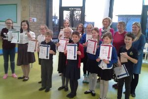 Members of the Duns and District Children's Scottish dancing class with their Medal Test certificates.