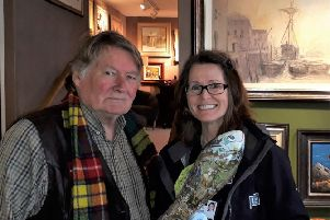 Maritime artist Peter Knox and Claier McIntosh with one  the fishes to be auctioned to raise funds for the Fishermen's Mission.