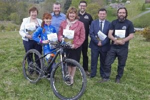 Kathy Gilchrist, Isla Short, Graham McLean, tourism secretary Fiona Hyslop, Danny Cowe, Nick Antonopoulis and Geraint Florida-James at Glentress on Tuesday for the announcement of the �185,000 payout.